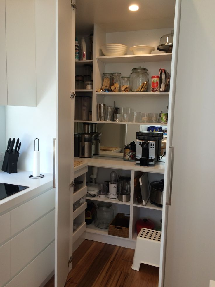 Walk in pantry in a narrow semi with appliances on bench and drawers