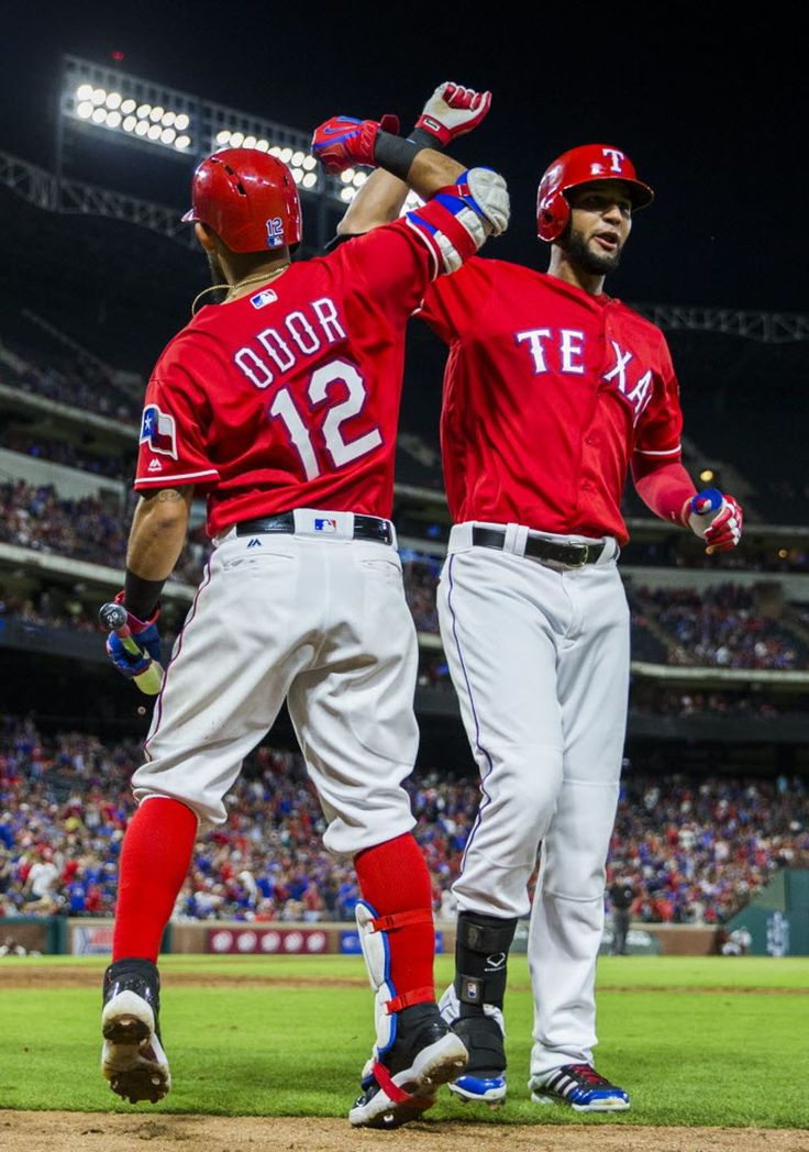 Texas Rangers second baseman Rougned Odor (12) high-fives right fielder Nomar Mazara (30) after Mazara hit a home run during the eighth inning of their game against the Seattle Mariners on Saturday, June 4, 2016 at Globe Life Park in Arlington, Texas. (Ashley Landis/The Dallas Morning News)