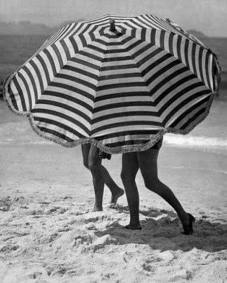 Striped beach umbrella, c. 1950s.