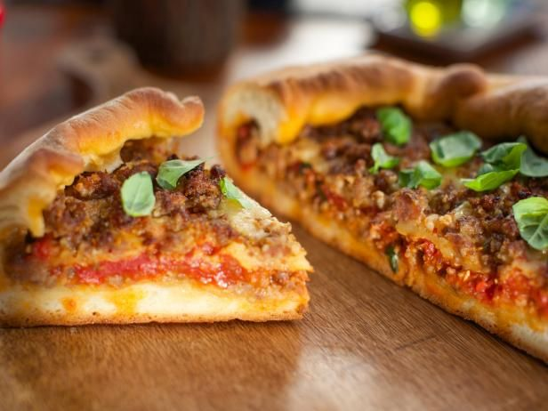 Get Deep-Dish Sausage Pizza Recipe from Food Network. Could do with peppers & onions instead of sausage, mmm