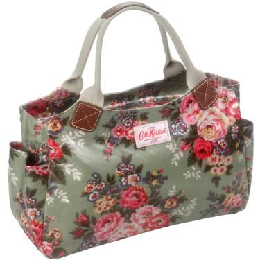 I have this purse! It's made out of oilcloth and still looks new. I love it love it love it!! So cute.