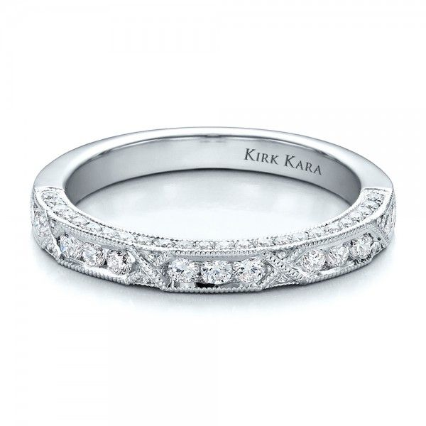 #100120 Kirk Kara designer jewelry is available at Joseph Jewelry.This beautiful women's wedding band has round channel set diamonds trimmed with...
