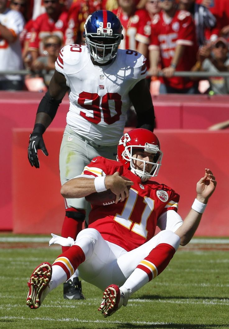Best of NFL Week 4 | Kansas City Chiefs quarterback Alex Smith (11) slides down after getting past New York Giants defensive end Jason Pierre-Paul (90) during the first half of an NFL football game at Arrowhead Stadium in Kansas City, Mo., Sunday, Sept. 29, 2013. (AP Photo/Orlin Wagner)
