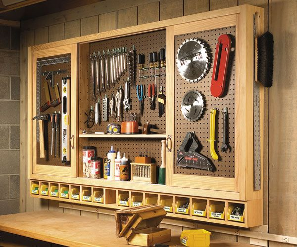 sliding door pegboard cabinet building plans - this could be super useful in a craft room too (paint it white or a pretty color and store craft supplies, etc).  might have to coerce dad into building this for me!  :)