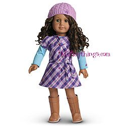 """2010 Pretty & Plaid Dress for Dolls + Charm  Item# G1689     When it's time for school, your girl can dress her doll in this casual outfit:        A purple plaid dress with a gathered yoke and a tie at the waist      A long-sleeved cotton tee to layer underneath      A cozy, knit beret with butterfly embroidery      Knee-high boots to match      A """"Smart"""" heart charm for the doll's charm-keeper necklace"""