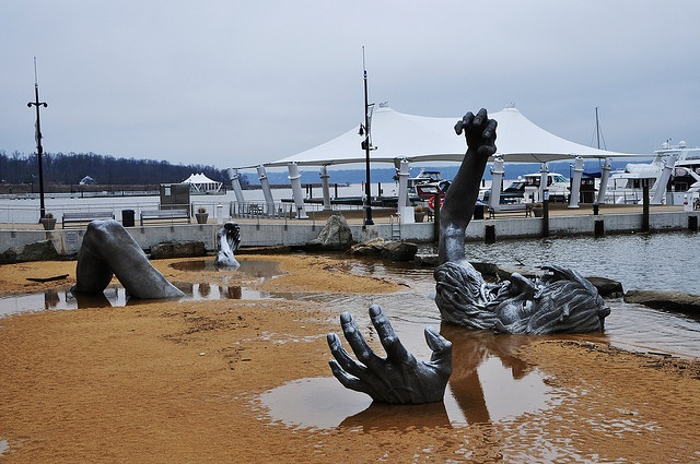 The Awakening. J. Seward Johnson, Jr. Now at National Harbour, Maryland. I love the puddles pooling around the limbs. How long before it's entirely covered by sand / or completely exposed?