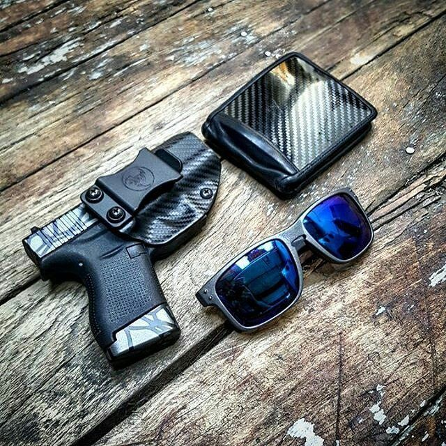 From @mbentwood1 Thursday is under way ....gray scale life .  @alexandryandesign carbon kydex holster. Carbon wallet from @turnermotorsport G43 with @hyvetechnologies Base plate in tungsten over armor black ... Glasses from some town in china...also cerakoted