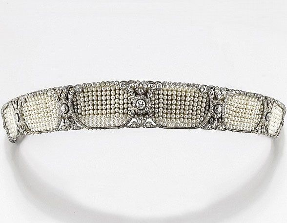 A bandeau / tiara with cartouche motifs in small pearl beads, woven between old-cut diamond swirls. It came in its original box. It was made by Gebrüder Friedländer of Berlin. He was the House Jeweler to the Princess Luise of Prussia in the early 1900s.