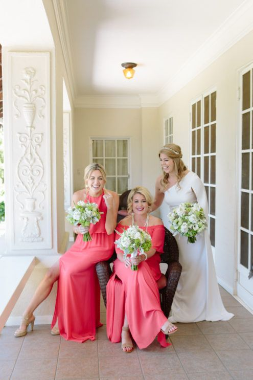 Beautiful coral colored bridesmaids dresses.