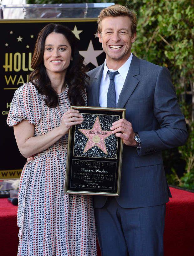 Simon Baker holding award