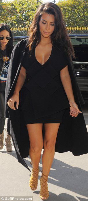 Strutting her stuff: Kim can turn any setting into her own personal catwalk and outside of her hotel in Paris was no different