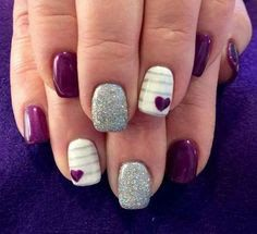 Purple and glitter silver nails with white and grey stripes and a Purple Heart