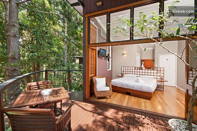 King size bed, french doors, wooden floor boards, stunning sub tropical forest views from private balcony.