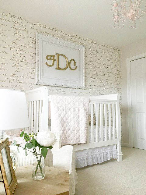 A DIY stenciled accent wall in a nursery using the French Poem Allover Stencil from Cutting Edge Stencils. http://www.cuttingedgestencils.com/french-poem-typography-letter-stencil.html