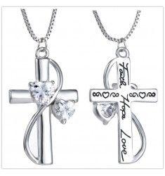 Halsband kors med en svepning runt korset prydd med kristall stenar.
