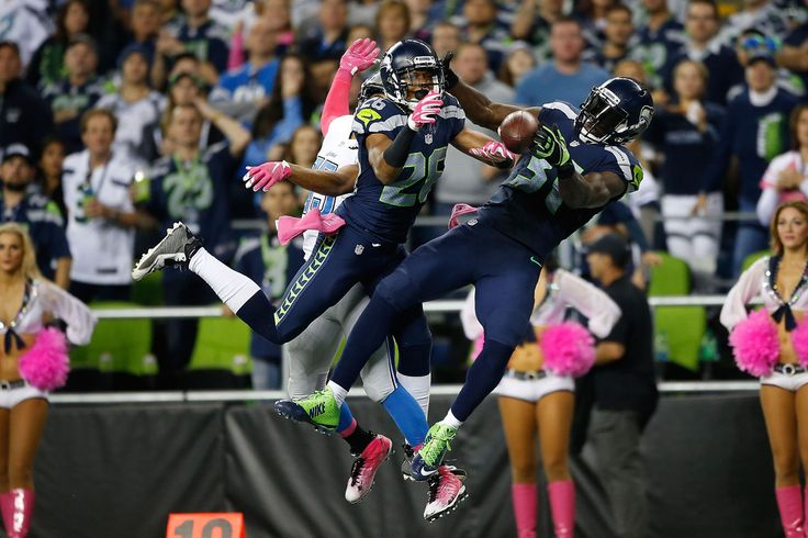 Cary Williams #26 of the Seattle Seahawks and Kam Chancellor #31 of the Seattle Seahawks defend a pass intended for Golden Tate #15 of the Detroit Lions during the second half of their game at CenturyLink Field on October 5, 2015 in Seattle, Washington. (Oct. 4, 2015 - Source: Otto Greule Jr/Getty Images North America)