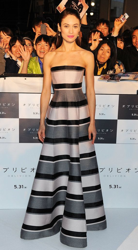 At the Japan premiere of Oblivion, Olga Kurylenko looked ladylike in a striped ball gown. She wore little else except for a pair of gold drop earrings