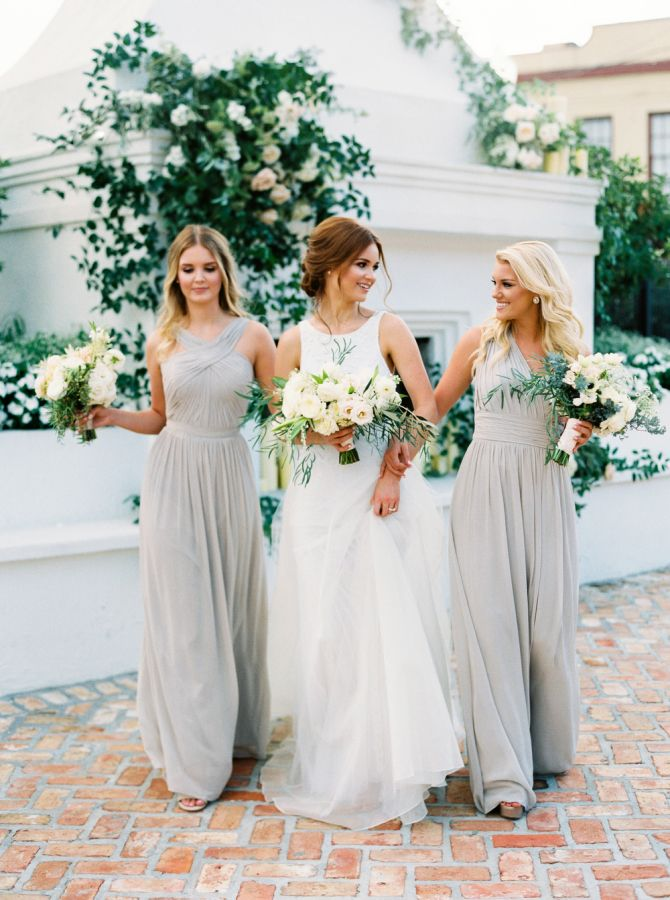 Elegant gray bridesmaid dresses: http://www.stylemepretty.com/2016/03/15/neutral-elegant-outdoor-wedding-inspiration/ | Photography: Greer Gattuso - http://www.greergphotography.com/