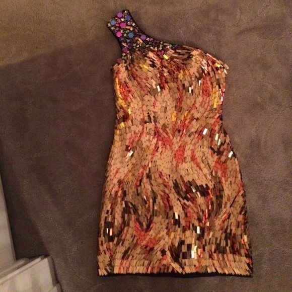 Gold and copper formal dress Great dress!! Worn once! No signs of wear! Gorgeous gold and copper bodice with multi colored gems across the one shoulder strap Dresses One Shoulder