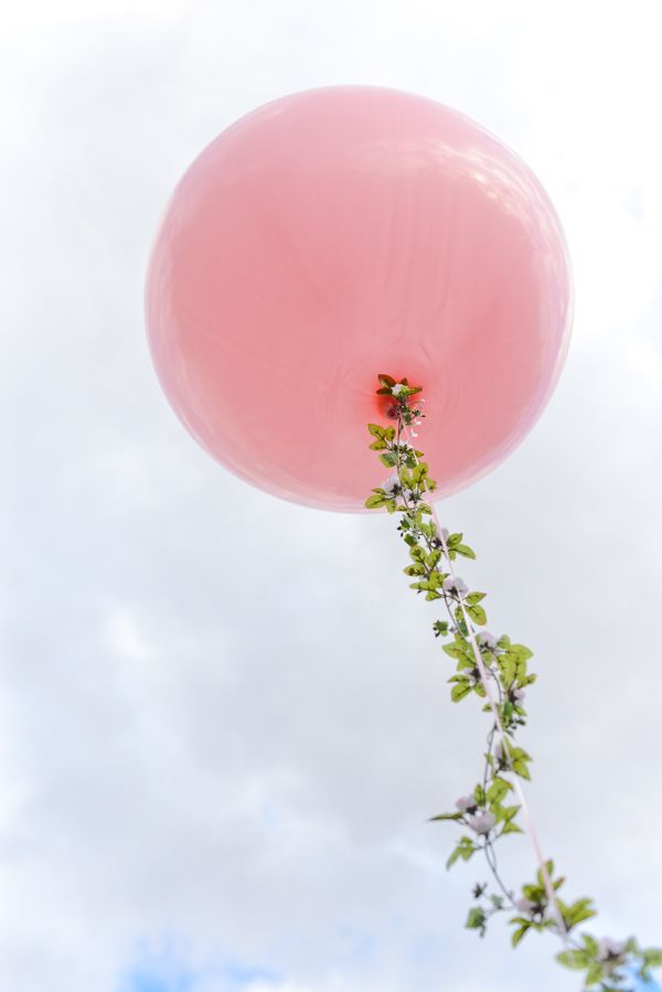 Big Balloon and a Floral Garland String.  Replace a helium balloon string with a floral garland and magic happens!  Perfect for weddings, spring parties, showers, and more.