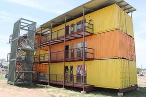 An apartment complex being built from shipping containers. A work in progress, but will be full size inside. 3 containers wide.
