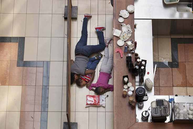 The 2014 Pulitzer Prize photography, woman &a children hiding at Westgate during attack by militants in Nairobi, Kenya, Sept. 21, 2013 by Tyler Hicks, New York Times