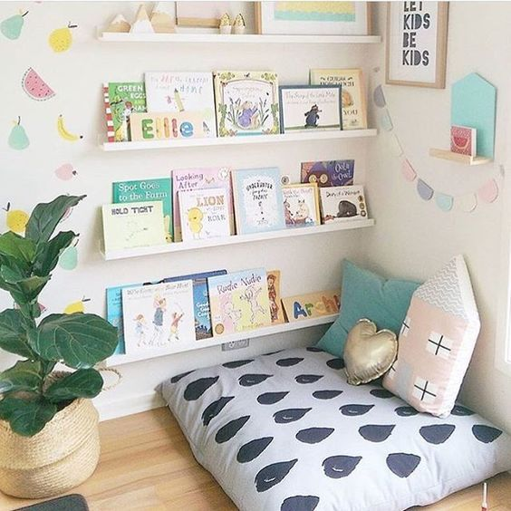 Cozy reading nook in a Montessori home with front-facing bookshelves at child level.
