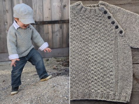 """Inspiration for a child's knit, pullover sweater (no pattern): """"Epipa's Gansey,"""" a raglan sleeved, plain-knit wool sweater with a textured front panel and ribbed openings. Buttoned placket along the front-left shoulder's raglan line can open the neckline to facilitate outfit changes. Garment of knitter's own design, posted on epipa.blogspot.de, 31 Dec. 2013. Yes, monolinguists, the blog is in German, but at least on Safari 7.0.3, Google Translate seems to work quite well."""