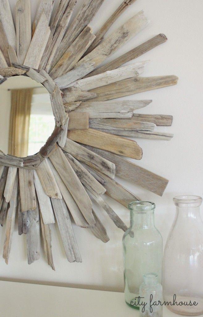 Apliques al marco de un espejo con trocitos de ramas