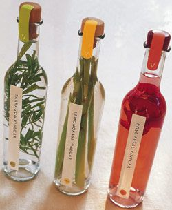 "Flavored Vinegars: instructions for infusing distilled white vinegar with tarragon, lemongrass, and rose petals. Posted by Nicole Deyton on http://100handmadegifts.blogspot.com/2006/11/38-flavored-vinegars.html; inspired by the book   ""Flavored Vinegars: 50 Recipes for Cooking with Infused Vinegars"" by Michael Chiarello and Penelope Wisner."