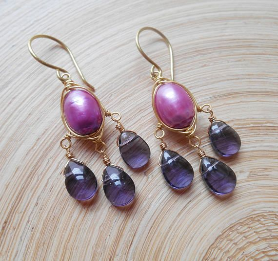 With a vibrant, juicy tone and stunning presence, Brigitte chandelier earrings look amazing worn with everything from comfy casuals to something more dressed up. The focal element of the composition is a lovely violet magenta freshwater potato pearl, which I wire wrapped with gold