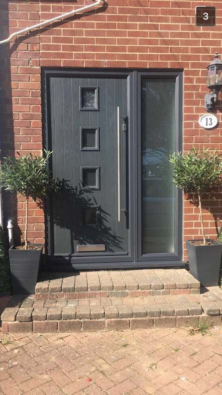 Uber chic, stylishly, modern Grey, 4 Square Composite Door with Long Bar Chrome Furniture.