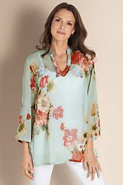 a little boho for us mature women :) see how this outfit balances .... The flowing top (great for hiding the tummy) and slim pant