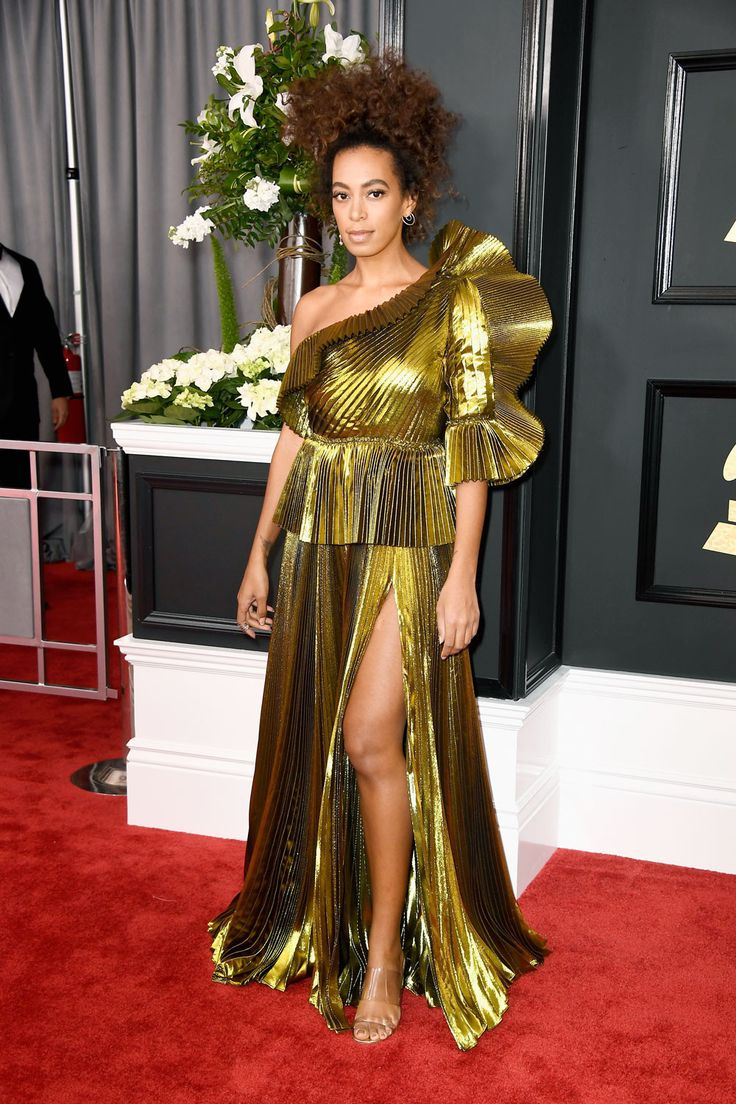 Solange Knowles attended the 2017 Grammy Awards in a glistening gold dress—see it here.