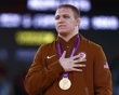 Jacob Stephen Varner of U.S. with his gold medal listens national anthem at the podium of the Men