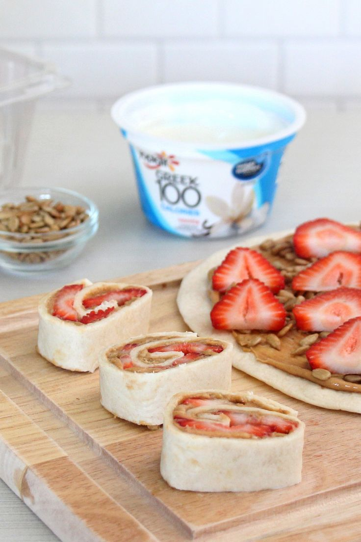 """Yoplait Greek 100 Vanilla yogurt """"sushi"""" with peanut butter, strawberries and sunflower seeds layered on a tortilla and cut into rolls is an awesome after school snack! Make it better with Yoplait Greek 100 yogurt layered on top or as a dip."""