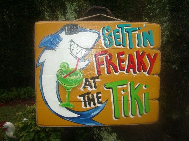 Gettin' Freaky at the tiki - Tropical Beach Pool Patio Hut Bar Sign Plaque. 39.95, via Etsy.