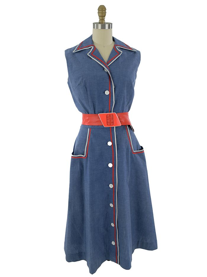 1950s day dress buttons down the front and has contrasting red and white braid trim. Cute & comfortable for summer. Add a straw bag and red wedge sandals.