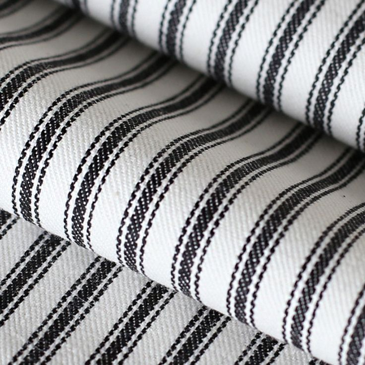 A classic, black and white ticking fabric. Suitable for drapery, roman blinds, upholstery, bedding accessories, pillows, cushions and other home decor items.Man