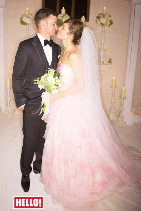 Jessica Biel married Justin Timberlake on October 19, 2012 at the Borgo Egnazia resort in Puglia, Italy. She chose a rose-pink strapless gown, enhanced with layers of delicate tulle by designer, Giambattista Valli, and finished with a unique floor length veil embellished with a personal touch – miniature heirloom pearls from her grandmother's wedding day tiara. The total cost for their wedding celebrations for a week with 100 guests cost them a reported $6.5 million dollars.