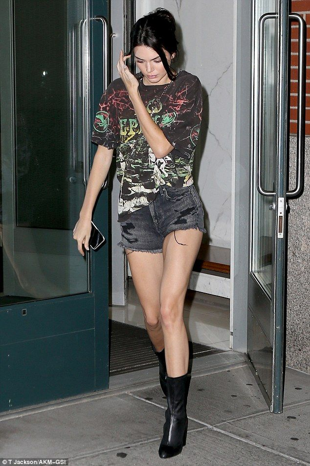Long limbs: The Keeping Up With the Kardashians star put her endless catwalk stems on display in black acid wash shorts