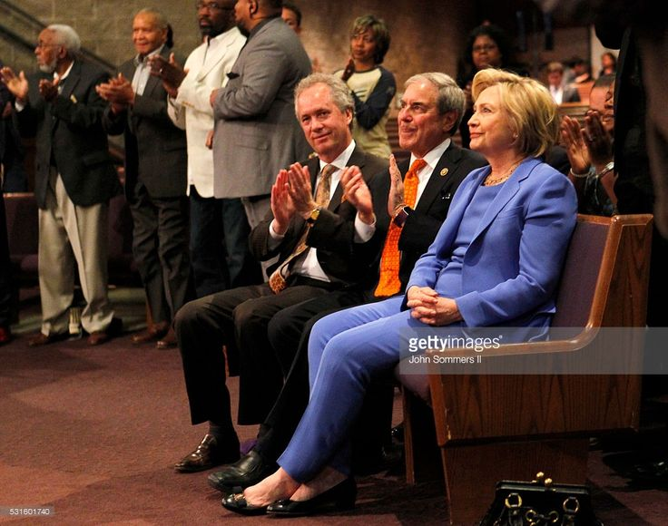 Democratic presidential candidate Hillary Clinton (R) sits with Congressman John Yarmuth (C) and Louisville Mayor Greg Fisher (L) during a church services at Canaan Missionary Church May 15, 2016 in Louisville, Kentucky. Clinton is preparing for Kentucky's May 17th primary.