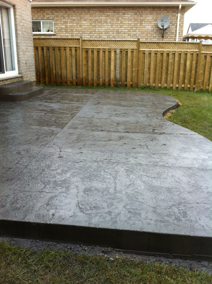 Rough Cut Stone Stamped Concrete Patio In London Ontario
