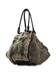 She accessorizes with over sized, rugged, statement handbags