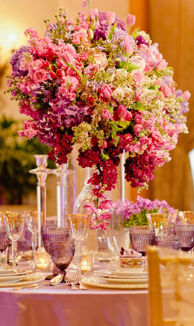 12 Stunning Wedding Centerpieces - Part 16 by Belle The Magazine - Love the different colour glasses on the tables