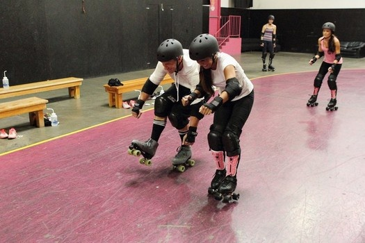"""Catherine roller skates with Sean Lowe during """"The Bachelor"""" season 17 episode."""