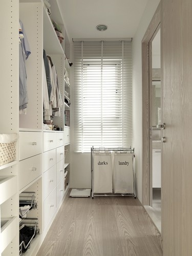 walkin closet, whole width of bedroom on blank wall, stuff on one side keeps it narrow but comfortable to access, bright and light