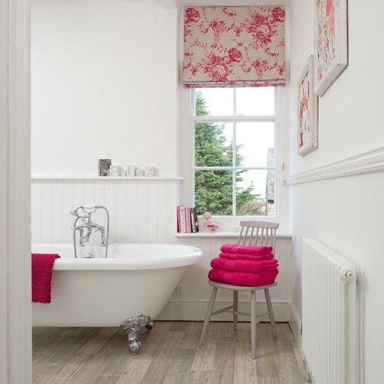 White panelled bathroom with pink accents