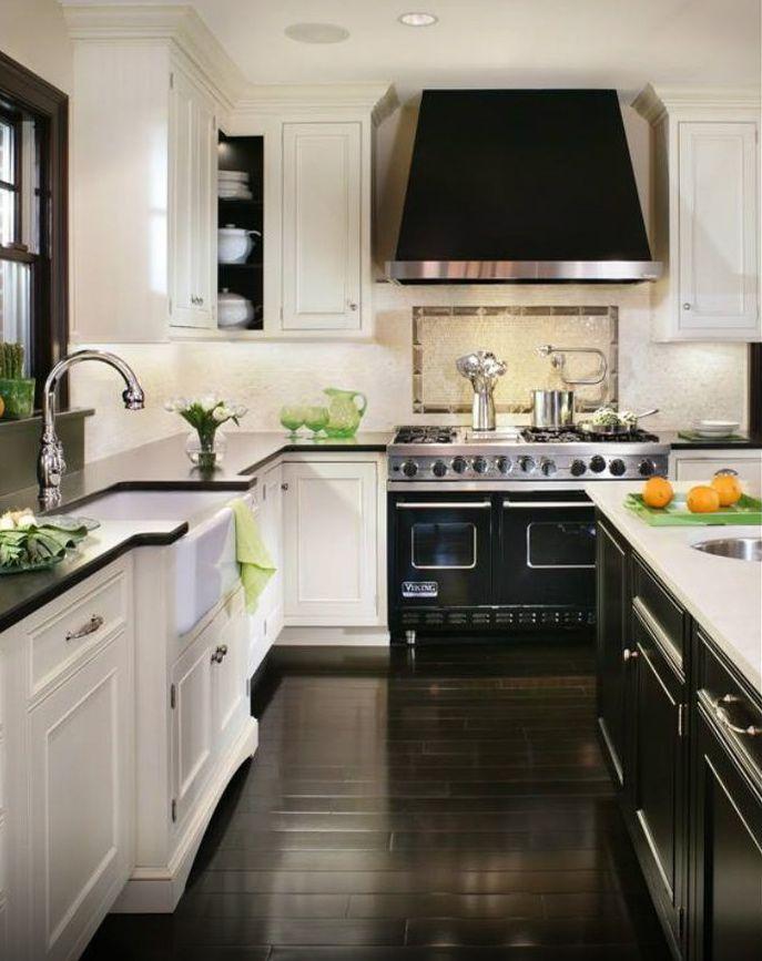White cabinets black counter, black island white counter, dark floors. - Kitchen