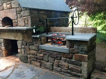 Building an outdoor kitchen with flagstone countertop, storage space for fire…